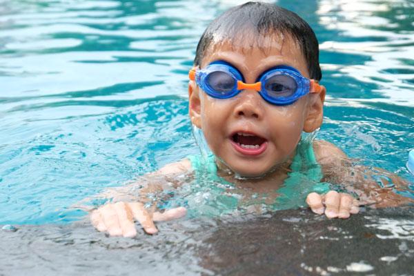 Asian-cute-boy-splashing-on-summer-pool_web